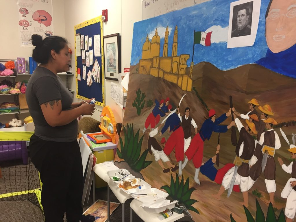 Parents work on materials for the Cinco de Mayo celebration